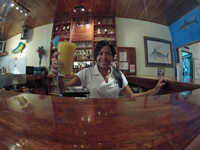 Maria serves up a mango daiquiri.