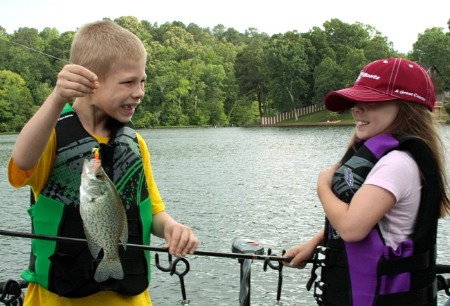 Benjamin and Lily admire a crappie.